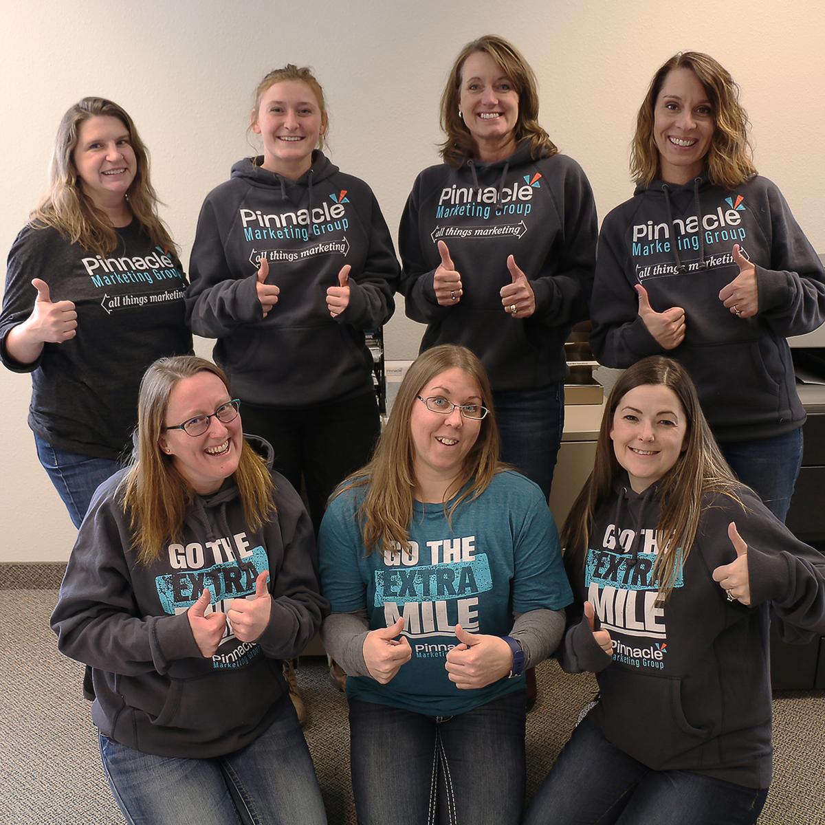 Pinnacle Marketing Group employees wearing PMG apparel