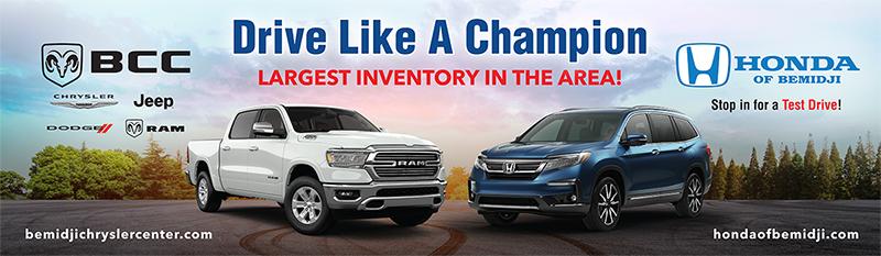 Bemidji Chrysler Center and Honda of Bemidji drive like a champion billboard advertisement