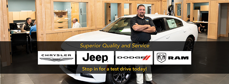 Bemidji Chrysler Center Facebook cover showing an employee standing by a white vehicle