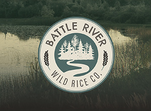Battle River Wild Rice logo on a background of a lake with wild rice growing