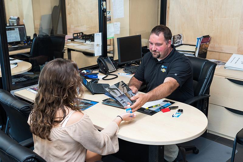 Bemidji Chrysler Center employee at a desk helping a customer