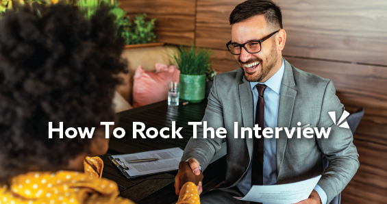 How to rock the interview blog description with image of a businessman shaking hands with a woman