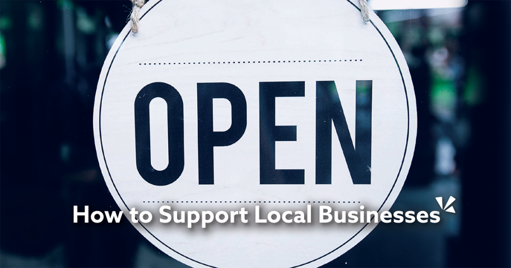 How to support local businesses blog description with image of open sign at a store