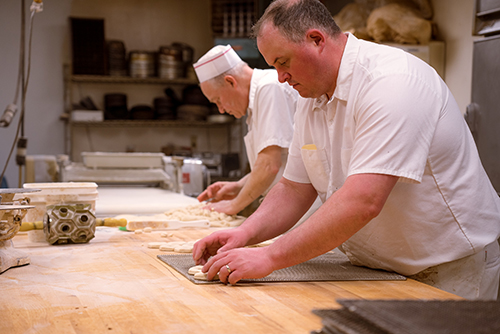 Raphael's Bakery employees creating baked goods in the kitchen