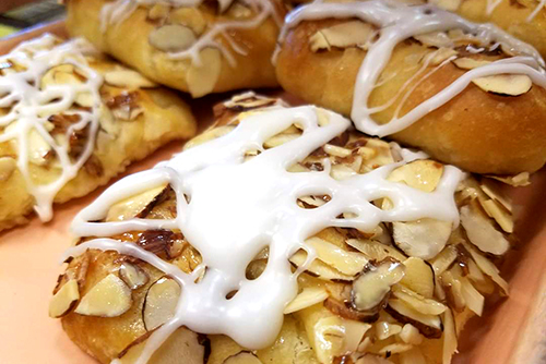 Raphael's Bakery donuts with icing and almonds