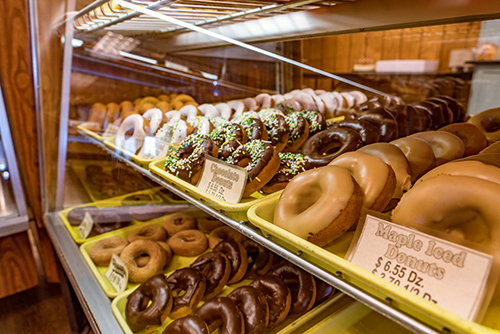 Raphael's Bakery donuts in a glass case