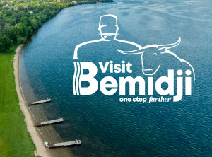 Visit Bemidji logo over image of lake Bemidji