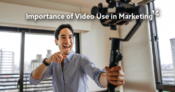 Importance of video use in marketing blog description with image of a man holding a video camera